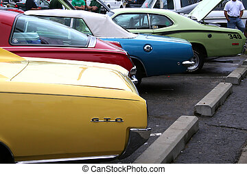 MUSCLE CARS - Colorful classic muscle cars in parking lot