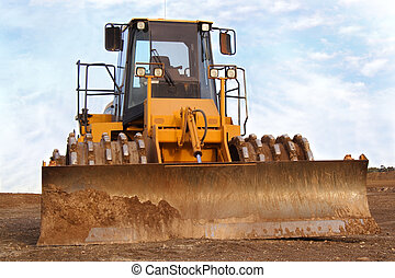 Earth mover - giant yellow earth mover on construction site