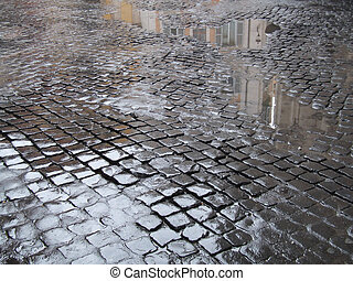 Wet cobbled street in Rome - Cobblestone - old street in...