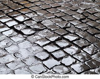 Wet street - Wet cobblestone in old town in a mediterranean...