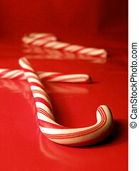 Candy Canes - Closeup of candy canes on red background