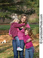 Mother and Daughters - mother and daughters smiling and...