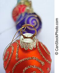 red Christmas bauble - Close-up of red Christmas bauble with...