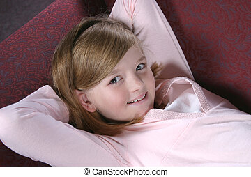 Kickin Back - pretty feminine preteen girl in pink laying on...