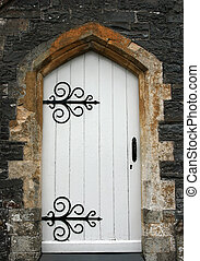 Ancient Doorway - Old stone arched doorway with white wooden...