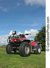 Quad Bike - Four wheel drive quad bike standing idle on the...