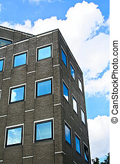 windows - Blue sky, clouds and nearby structures reflected...