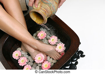 Beautifying feet - Warm water is poured into a footbath....