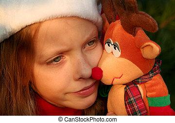 Christmas girl - Portrait of a little girl wearing Santa...