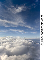 Blue sky and white clouds portrait - A blue sky and white...