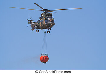 Fire Fighting - Air-Force Helicopter with a Bambi bucket...