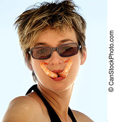 Girl with shrimp - Woman is holding two shrimp in her mouth