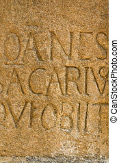 Carved stone in Sarlat, France - Letters carved in stone in...