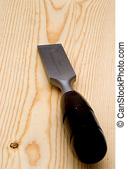chisel  - a chisel on a pine board