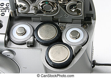 battery slots in a compact camera