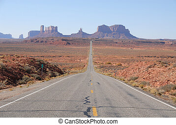 Monument Valley - Looking down the road in Monument Valley,...