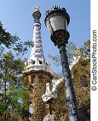 guell park entrance - house and lantern of antoni gaudis...