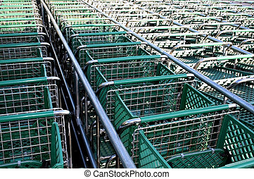 Shopping Carts - green colour shopping carts in a row
