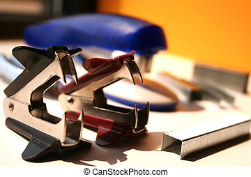 Staple Remover - staple remover office supplies on a table