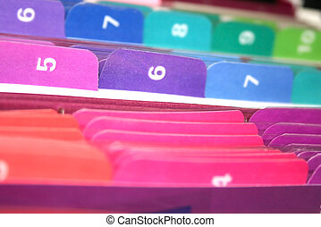 TABS OF FILES - Coloful files in the cabinet