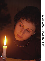 Candle Gazing Lady - A young attractive woman in evening...
