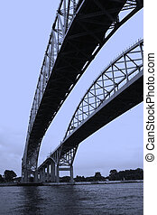 Blue water bridge shot from below