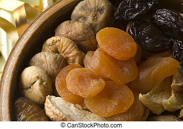 fruit - dry fruit in wooden bowl close up