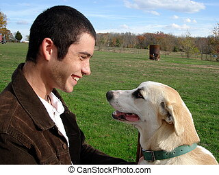 Mans Best Friend - A young man playing with his hound dog...