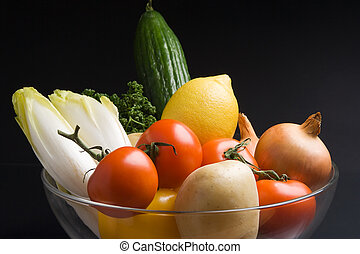 Fresh vegetables - A salad bowl full of fresh vegetables on...
