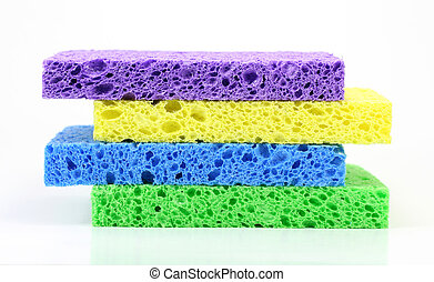 Colorful Sponge Stack - A stack of four colorful cleaning...
