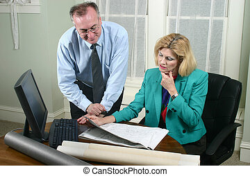 Architect And Client Looking At Blueprints 4 - Architect...