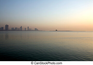 Palm Island - A single tree remains on Palm Island, in Doha...