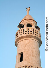 Minaret - The minaret of a traditional style mosque in Doha,...