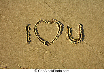 I LOVE YOU - text written in sand: I LOVE YOU, heart
