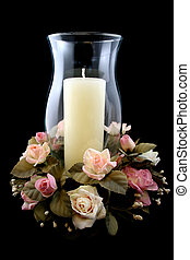 Holiday Candle and Flower Centerpiece on Isolated Black...