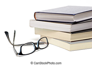 Books and glasses - Books and reading glasses on white...