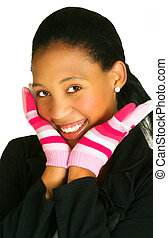 woman in gloves - young african woman with a bright smile...
