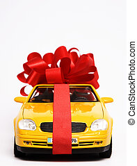 Luxury present - Yellow sports car wrapped in red ribbon