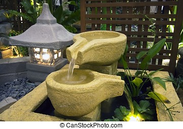 Japanese Fountain - A japanese fountain decoration in the...