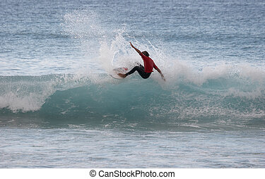 Surfing - Surfer on a crest of a wave
