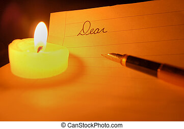 Candlelit Letter - A tea candle, fountain pen, and the...