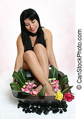 Botanical foot bath - Sit back and relax. A woman enjoys the...