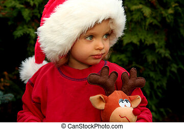 Christmas baby - Portrait of a baby girl wearing Santa Claus...