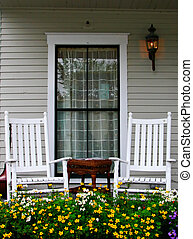 Porch and Chairs - A porch with two chairs and a flower bed