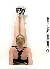 Strething out - woman with legs up against the wall...