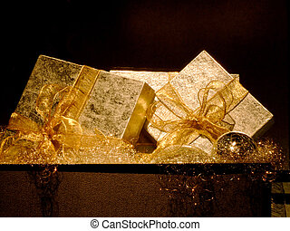 Golden gifts - Two big silver gift boxes with golden bow
