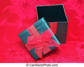 Christmas Box - Photo of a green box with a red ribbon tied...