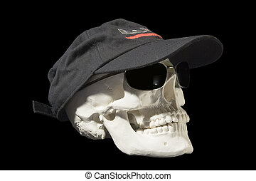 Skull in sunglasses - An isolated skull wearing a black cap...