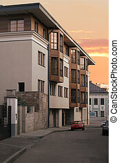 Four-floors house in centre of town at evening. Center of...