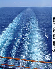 Cruise ship wake, blue water and sky